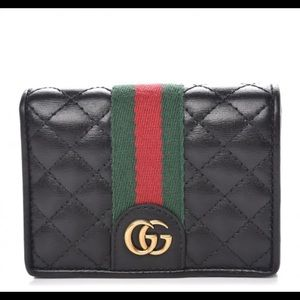 Womans Gucci black wallet - GG gold hardware